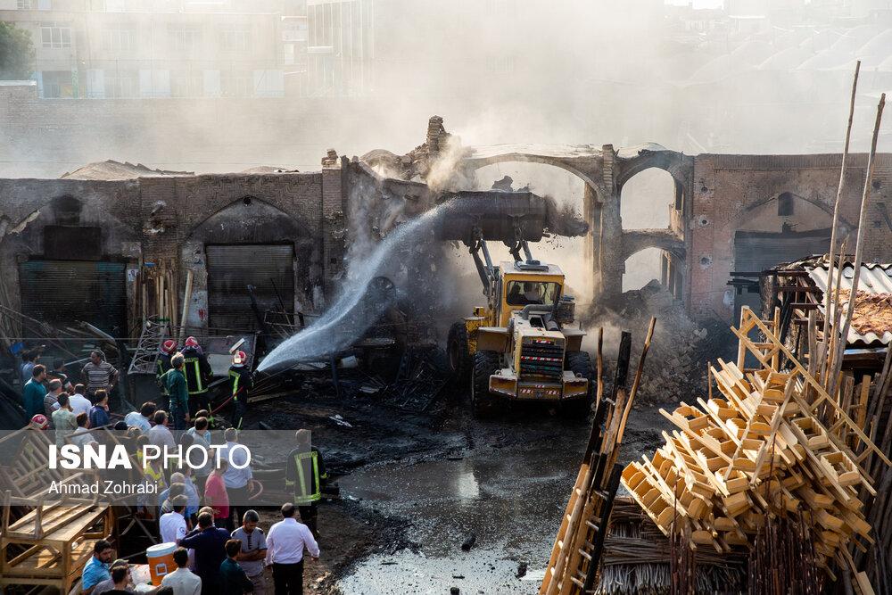 آتش سوزی و تخریب سر در کاروانسرای ملاحسین بازار کهنه قم